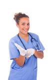 Potomstwa fabrykują z stetoskopem z rękawiczkami odizolowywać na bielu plecy Obrazy Stock