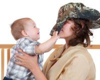 Potomstwa matkują bawić się z jej synem Zdjęcie Royalty Free