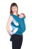 Potomstwa matkują z dzieckiem w temblaku obraz stock