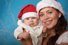 Potomstwa matkują z jej słodkim dzieckiem fotografia royalty free