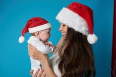 Potomstwa matkują z jej słodkim dzieckiem obraz royalty free