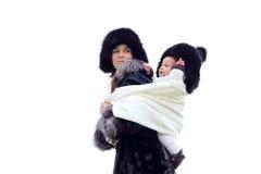 Potomstwa matkują z dzieckiem w temblaku Fotografia Royalty Free