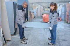 Potomstwa składują pracowników trzyma metalu talerza Obraz Stock