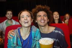 Potomstwo para ogląda film Zdjęcia Royalty Free