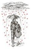 Potomstwo para pod parasolem w deszczu Zdjęcia Royalty Free