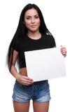 Potomstwo uśmiechu kobieta pokazuje pustego plakat Obraz Royalty Free