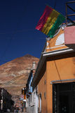 Potosi street, bolivian flag and Cerro Rico Stock Photos
