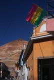 Potosi street, bolivian flag and Cerro Rico stock photos
