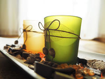 Potpourri and candle glass in sunlight Stock Image