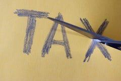 Potrącenie Podatku - nożyce ciący podatki fotografia stock
