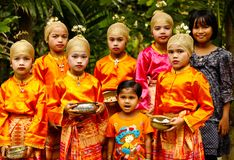 Potrait of Acehnese children. A group of kids were using Acehnese clothes, they're preparing to do a dance reception at a wedding reception that uses custom aceh stock image