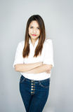 Potrait Asia lady smile ,cross one arm in cashual suite,White Sh Stock Images