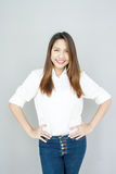 Potrait Asian lady mini smile in casual suite White Shirt and bl. Ue jeans royalty free stock images
