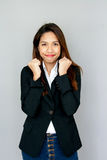 Potrait Asian lady show handful and smile on gray isolate Stock Photography