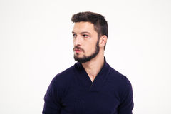 Potrait of attractive thoughtful young man with beard in sweetshirt Stock Photo