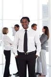Potrait of a Businessman standing in front of team Royalty Free Stock Image