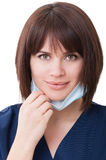 Potrait of a friendly woman dentist. On white studio background Stock Photography