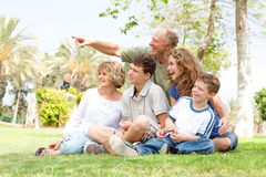 Potrait of grandfather pointing with family Stock Images