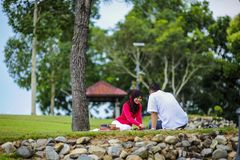 Potrait of happy young couple enjoying a day in park together. In Malaysia stock image