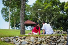 Potrait of happy young couple enjoying a day in park together. In Malaysia stock photo