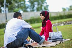 Potrait of happy young couple enjoying a day in park together. In Malaysia royalty free stock photos