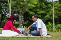 Potrait of happy young couple enjoying a day in park together. In Malaysia royalty free stock photography