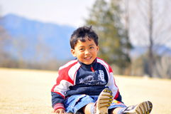Potrait of a Malay boy. The portrait of a smiling Malay boy in the spring season Royalty Free Stock Photos
