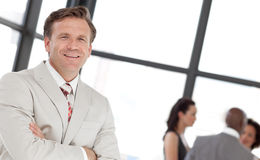 Free Potrait Of A Business Man In Front Of Team Stock Photo - 9041950