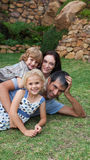 Potrait Of A Young Family In The Garden Royalty Free Stock Photography