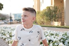 Potrait of a preteen with just made modermnstylish haircut stock photography