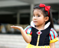Potrait princes dress with cute asian girl. Potrait princess dress with cute asian girl show hand for hold something Stock Photos