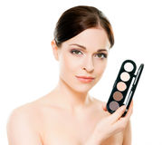 Potrait of a woman holding a makeup palette Stock Photography