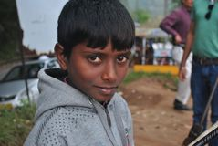 Potrait of a young Boy working as a street vendor at Kerala. Potrait of a young boy working on the streets of Keralarnsmiling & working hard Stock Photography