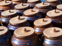 Pots. Clay pots stand in a line stock photography
