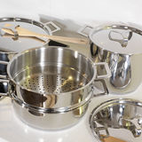 Pots. Metallic pots to cook with spoon of wood Royalty Free Stock Photography