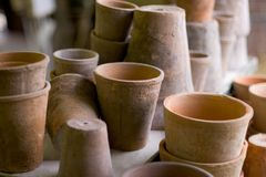 Pots. Clay pot pile, shallow DOF royalty free stock images