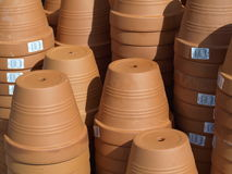 Pots. Brown pots in the shop background royalty free stock photo