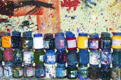 Pots of acrylic colors. In a painter studio royalty free stock photos