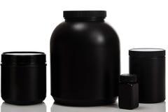 Pots avec des compléments alimentaires Photographie stock libre de droits