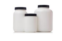 Pots avec la protéine d'additif d'isolement sur le blanc images libres de droits