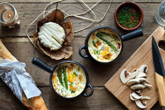 Pots with baked eggs Royalty Free Stock Image