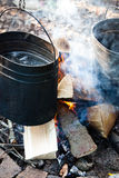 Pots on the campfire. Making a food in pots on the campfire Royalty Free Stock Image
