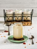 Caramel yogurt. Pots of caramel yogurt on a white table board stock images