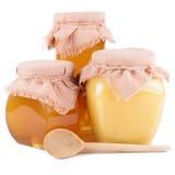Pots de miel sur un fond blanc Images libres de droits