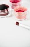 Pots de peinture en poudre par rose Photo stock