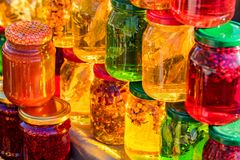 Pots with different sorts of honey. Glass jars with different sorts of honey in Russian marketplace Stock Images