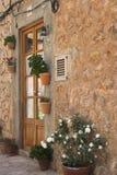 Pots & door. Old spanish house with terracotta pots & wooden  door Stock Photography