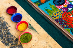 Pots of dyed sawdust and Holy Week processional carpet close-up Stock Photo