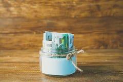 Pots en verre avec des dollars et euro espace libre pour le texte Photographie stock