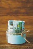 Pots en verre avec des dollars et euro espace libre pour le texte Photographie stock libre de droits